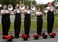 Section of the horn line warming up before the show in Kingston, NY. August 8, 2009